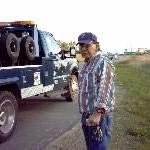 Roland John Morris Sr. watching his RV be towed